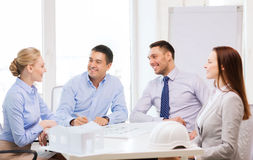 Happy team of architects and designers in office. Business, architecture and office concept - happy team of architects and designers in office Stock Image