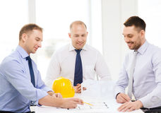 Happy team of architects and designers in office. Business, architecture and office concept - happy team of architects and designers in office Royalty Free Stock Photography