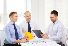 Happy team of architects and designers in office. Business, architecture and office concept - happy team of architects and designers in office Royalty Free Stock Images