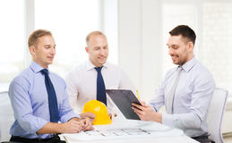 Happy team of architects and designers in office Stock Images