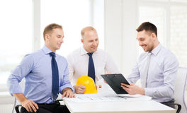 Happy team of architects and designers in office. Business, architecture and office concept - happy team of architects and designers in office Stock Photo