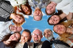 Happy team. On blue sky Stock Photo