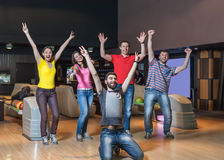 Happy team in bowling Royalty Free Stock Photos