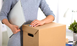 Happy team of businesspeople moving office Stock Photo