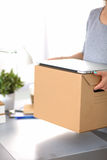 Happy team of businesspeople moving office Stock Photography