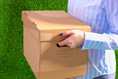 Happy team of businesspeople moving office, packing boxes, smiling Royalty Free Stock Images