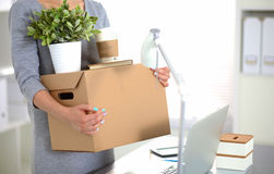 Happy team of businesspeople moving office, packing boxes, smiling Stock Photos