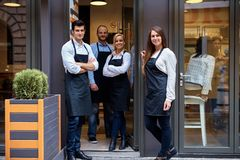Happy team of cafeteria Stock Image