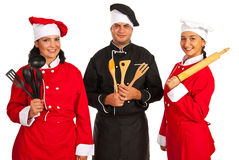 Happy team of chef holding utensils Royalty Free Stock Photography