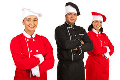 Happy team of chefs. Standing in a line with arms folded isolated on white background Stock Images