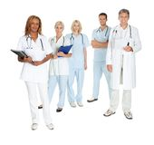 Happy team of doctors and surgeons on white Royalty Free Stock Photos