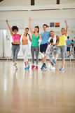 Happy team in fitness class. After training Royalty Free Stock Photo