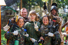 Happy team of five paintball players outdoors Royalty Free Stock Image