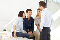 Happy team having a meeting Stock Photography