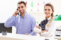 Happy team of hotel receptionists Stock Image