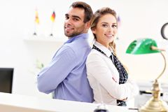 Happy team of hotel receptionists Stock Photography