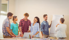 Happy team looking at their work Royalty Free Stock Photos