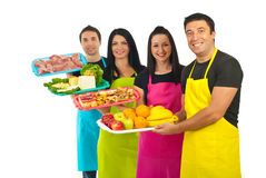 Happy team of market workers with fresh food Royalty Free Stock Images