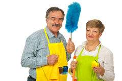 Happy team of mature cleaning people. Holding objects isolated on white background stock image