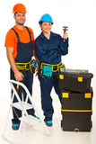 Happy team of plumbers Stock Photo