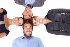 Happy team putting heads together Stock Image