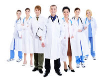 Happy team of successful doctors. Standing together in hospital gowns stock photography
