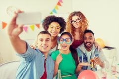 Happy team taking selfie at office party royalty free stock photos