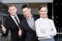 Happy team before work. In business centre Stock Photos
