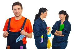Happy teamwork of cleaning workers. Smiling or laughing isolated on white background royalty free stock photo