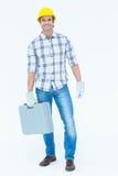 Happy technician carrying tool box Stock Photo