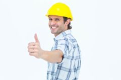 Happy technician gesturing thumbs up. Portrait of happy technician gesturing thumbs up over white background Stock Image