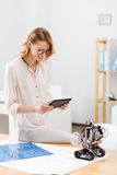 Happy technology specialist working with robot in the laboratory Stock Photo