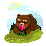 Happy Teddy Bear smelling a flower. Happy little bear smelling a flower in a clearing in the woods Stock Photo