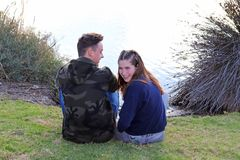 Happy teen age couple having fun in the park Stock Photos