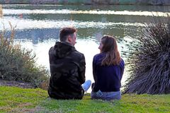 Happy teen age couple having fun in the park Royalty Free Stock Images