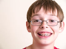Happy teen boy with braces smiling Stock Photo