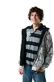 Happy teen boy with headphones. Portrait of a teen boy with his headphones on isolated on white Royalty Free Stock Photos
