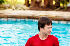 Happy teen boy in swimming pool with copy space. Stock Photo