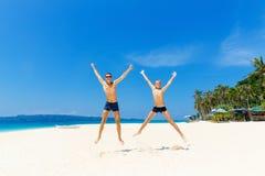 Happy teen boys having fun on the tropical beach. Summer vacatio Stock Photography
