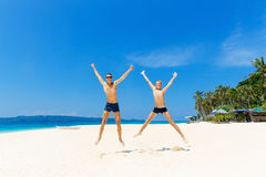 Happy teen boys having fun on the tropical beach. Summer vacatio. N concept Royalty Free Stock Photography