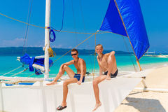 Happy teen boys on the sailboat on the tropical beach. Summer va Royalty Free Stock Image