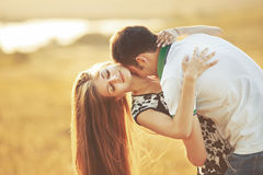 Happy teen couple embracing. Royalty Free Stock Photo