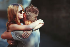 Happy teen couple embracing. At street. Great relationships royalty free stock images