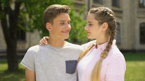 Happy teen couple kissing and looking at each other, pure relations, tenderness. Stock footage stock video footage