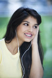 Happy teen with ear pods Stock Photos