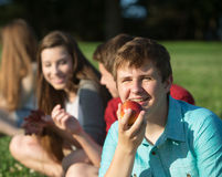 Happy Teen Eating Fruit Stock Images