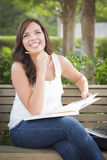 Happy Teen Female Student on Bench Outdoors Royalty Free Stock Image