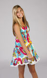 Happy teen girl. A beautiful young teen girl wearing a pretty colorful dress stock photos