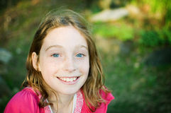 Happy teen girl. Close up of a smiling twelve year old girl Stock Photo