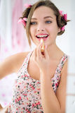 Happy teen girl applying lipstick Royalty Free Stock Images